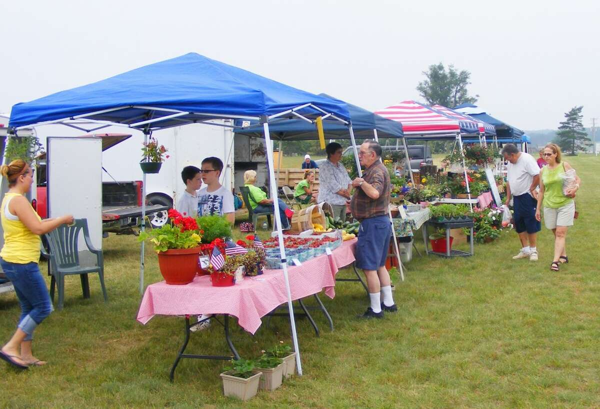 Local economies: Last year, thousands flocked to their local farmers markets to buy local food, plants and other products, while generating millions in state revenue. (File photo)