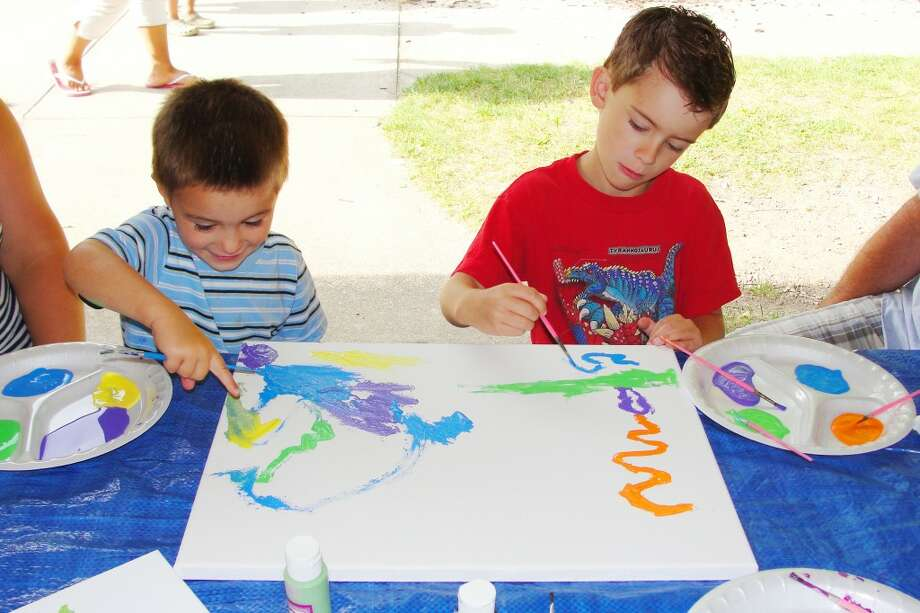IMPROVING ARTISTIC SKILL: Brothers Tristin, 6, and Braedan, 4 collaborate to create a colorful acrylic painting. (Shannon Hartley photo/Herald Review)