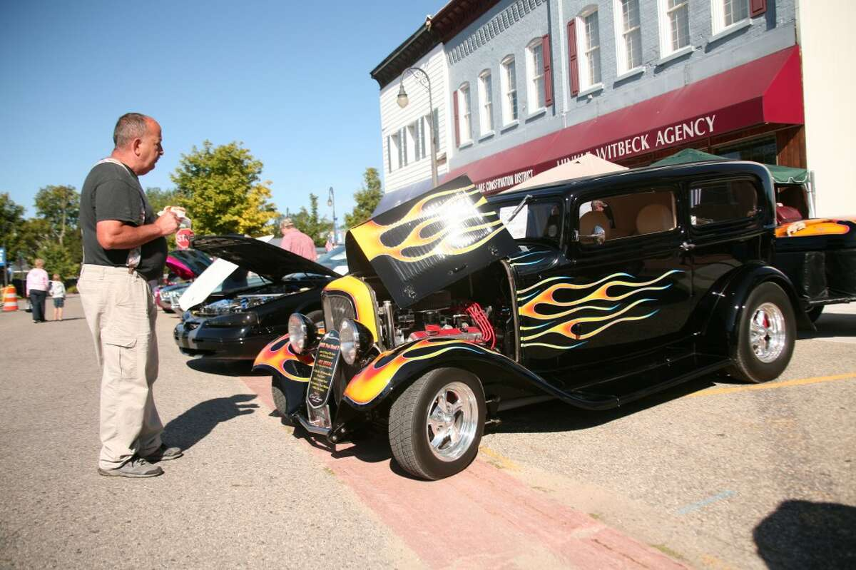 CLASSIC CAR: Rod Brinkman admires a 1932 Ford Model B hot rod during the car show at the 2012 Great American Crossroads Celebration. The eighth annual festival was held over five days at various locations throughout Reed City. (Herald Review/Jonathan Eppley)
