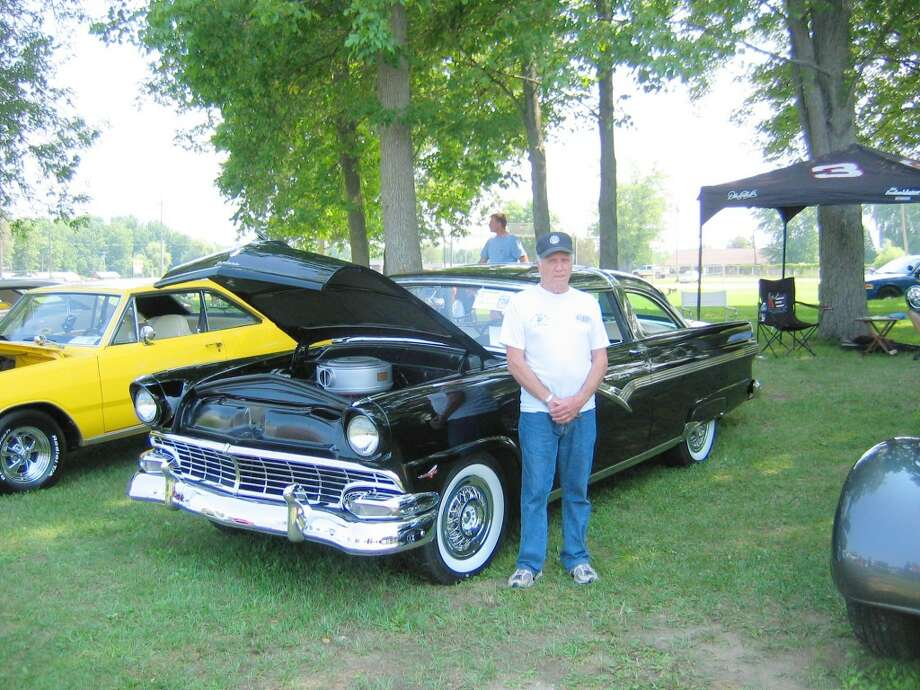 Classic cars: Tom Leski from Elmira poses with his 1956 Ford Crown Victoria at last year's Marion Days Car Show.This year, Marion Days will take place from Aug. 1 through Aug. 3 and offer a number of events for all ages, including parades, tractor pulls, a golf scramble, softball tournaments, bounce houses and more. (Herald Review file photo)