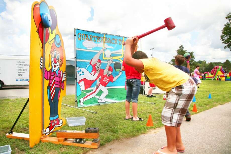 FUN AND GAMES: This year's Great American Crossroads Celebration in Reed City will feature a number of events for the entire family, including carnival-style games, inflatables, softball tournaments, a car show and more. (Herald Review file photo)