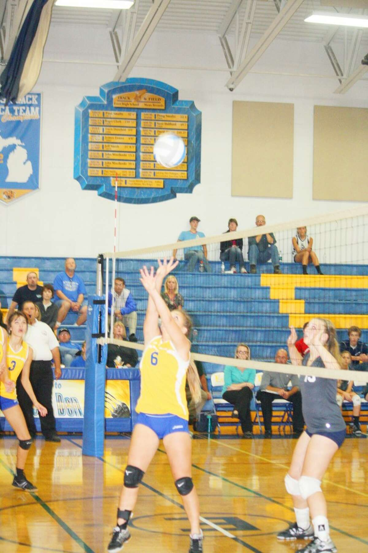 Tabby Turley (6) plays the ball for Evart in volleyball action last Thursday against Montabella. (Herald Review photo/John Raffel)