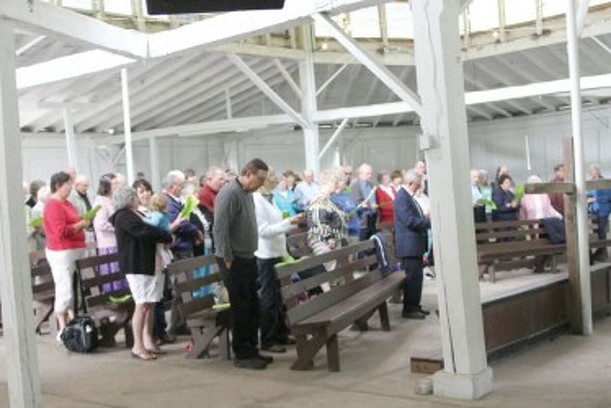 COMMUNITY GATHERING: Around 100 people gathered in the tabernacle at Albright Campground Sunday for a community worship service. (Courtesy photo)
