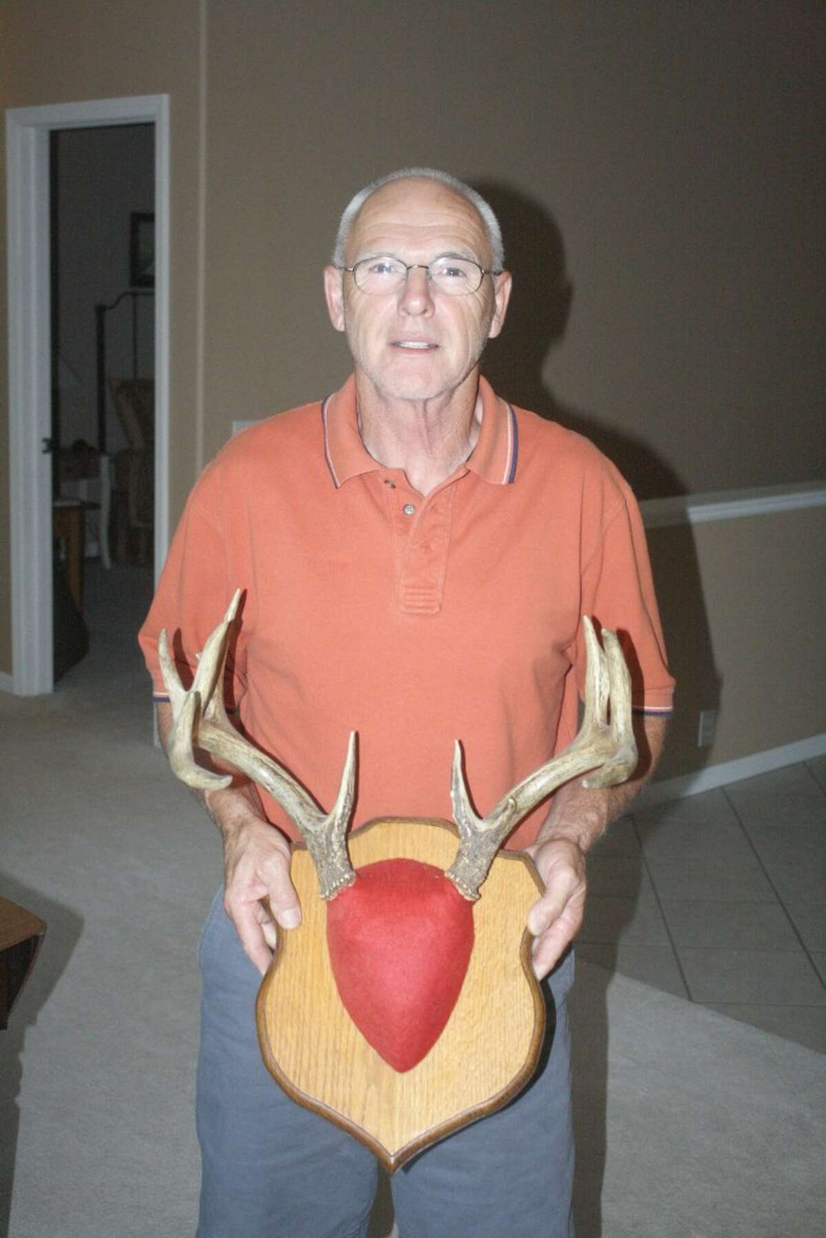 TROPHY BUCK: Reed City's George Vasicek shows the rack of a trophy buck he has shot during his hunting career. (Herald Review photo/John Raffel)