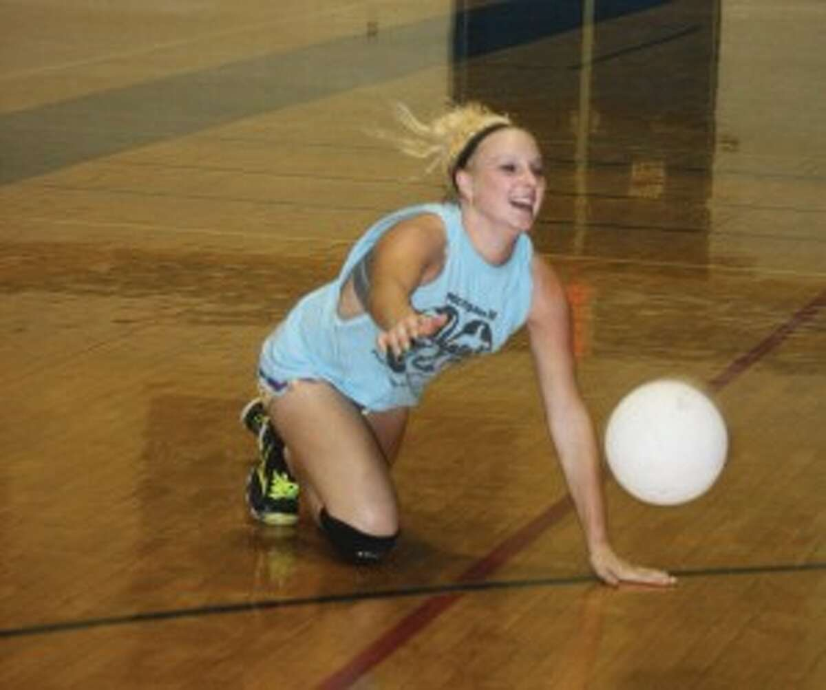 REACHING OUT: Saige Nabozny of Evart goes after the ball in a practice. (Herald Review photo/John Raffel)