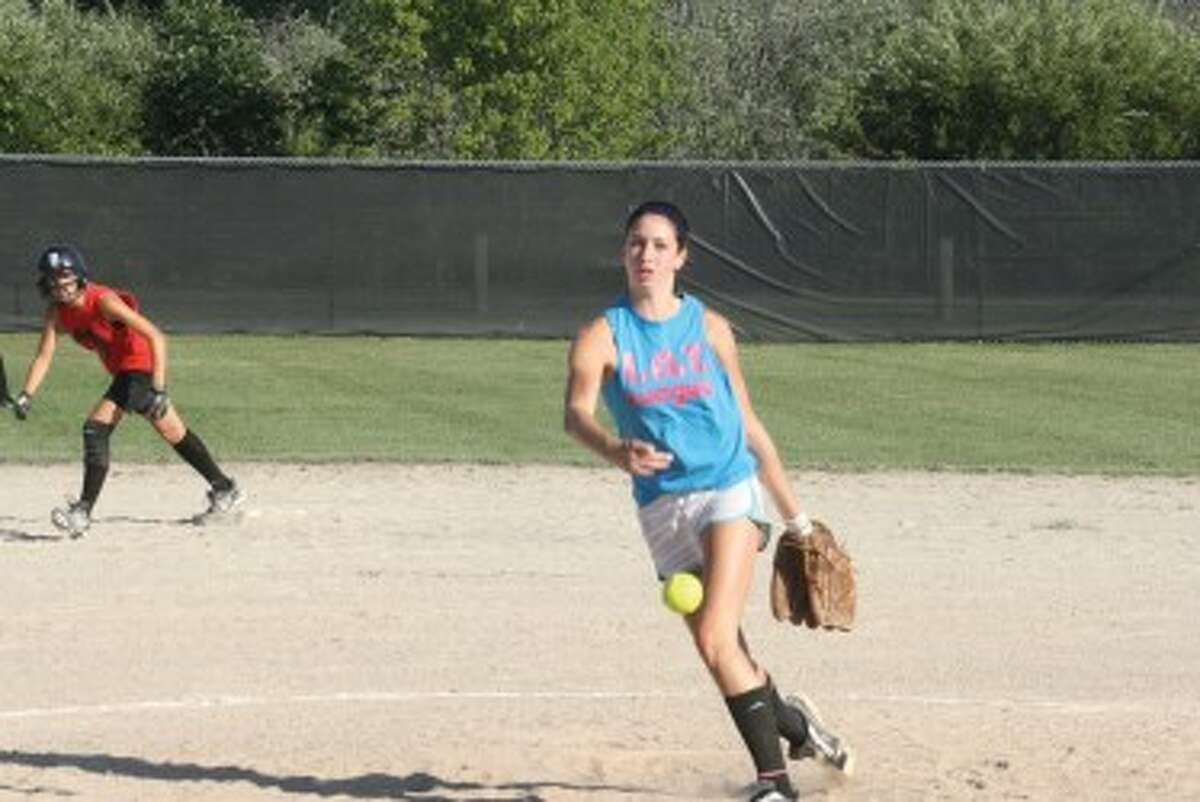 MAKING A PITCH FOR VARSITY: Paige Esiline of Pine River delivers a pitch against Reed City. (Herald Review photo/John Raffel)