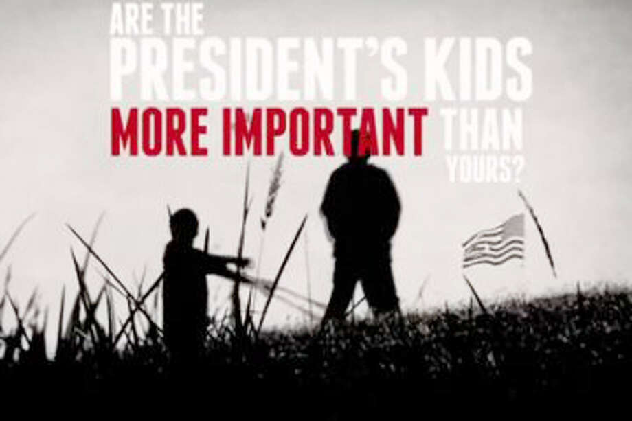 ADVERTISEMENT: An image from the recent NRA ad that brought the President's children into the political fray. (Screen capture)