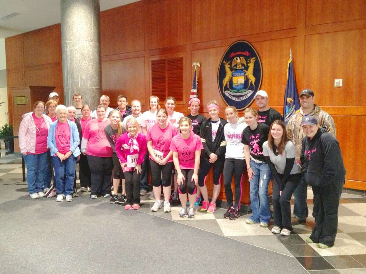 WALKING FOR THE CURE: The Pink 4 Pontz team poses for a photo before running in the Susan G. Komen Race for the Cure in Lansing on April 28. The team was formed in honor of Emily Pontz and her fight against breast cancer. (Courtesy photo)