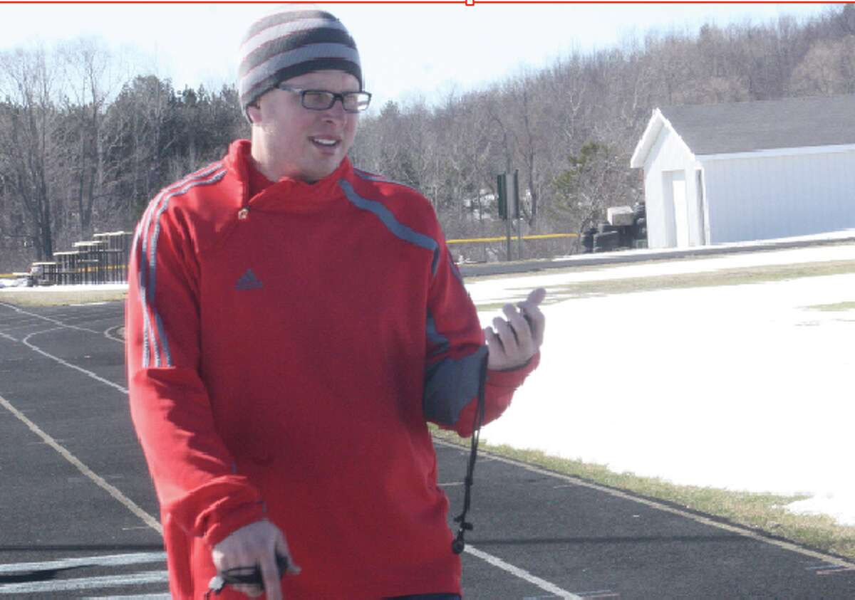 Early practice: Scott Gebhard of Pine River started the track season in early April, conducting practices during wintry conditions. (File photo)