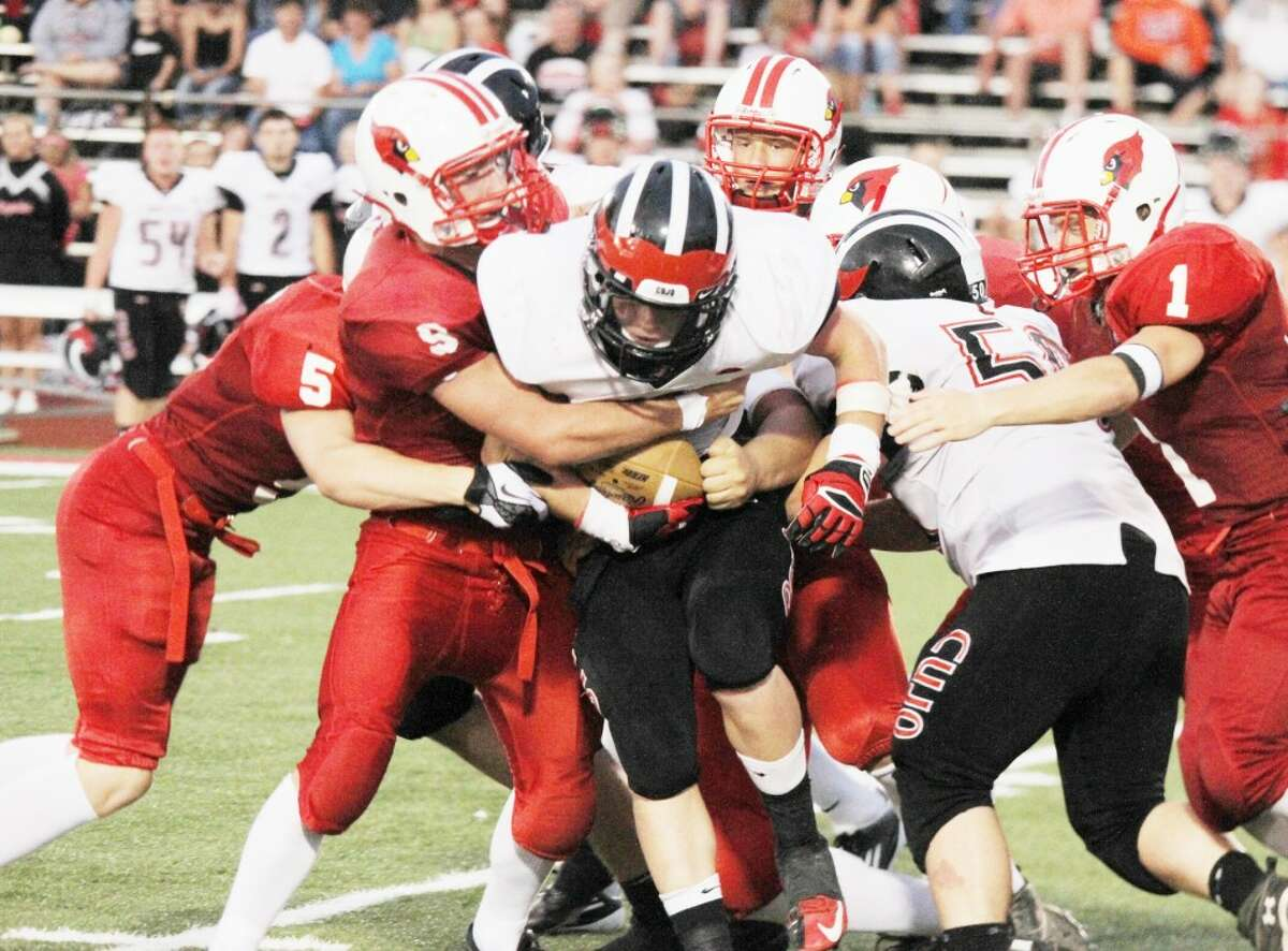 GANGING UP: Reed City running back Garrett Benson is wrapped up by several Big Rapids players during Friday's high school football action. Reed City won the game, 14-6. (Pioneer photo/Bob Allan)