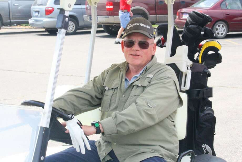 Mens golf: Jim Staton of Bitely gets ready for a round of golf at Marquette Trails Golf Club. (Herald Review/John Raffel)