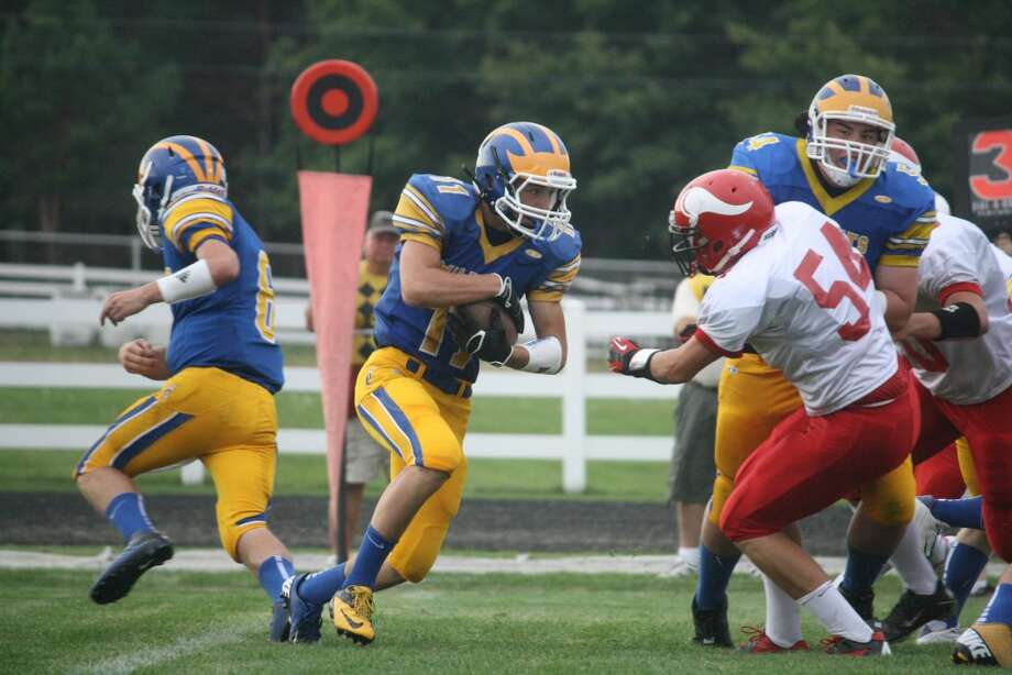 FULL SPEED AHEAD: Evart takes the ball down the field against Suttons Bay during high school football action on Friday. (Pioneer photo/John Raffel)