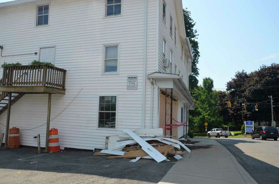 Resident has to be evacuated from this building on 1 Cherry Street, Milford early Saturday morning after it was struck by a car driven by an Ansonia woman. Photo: / Jill Dion