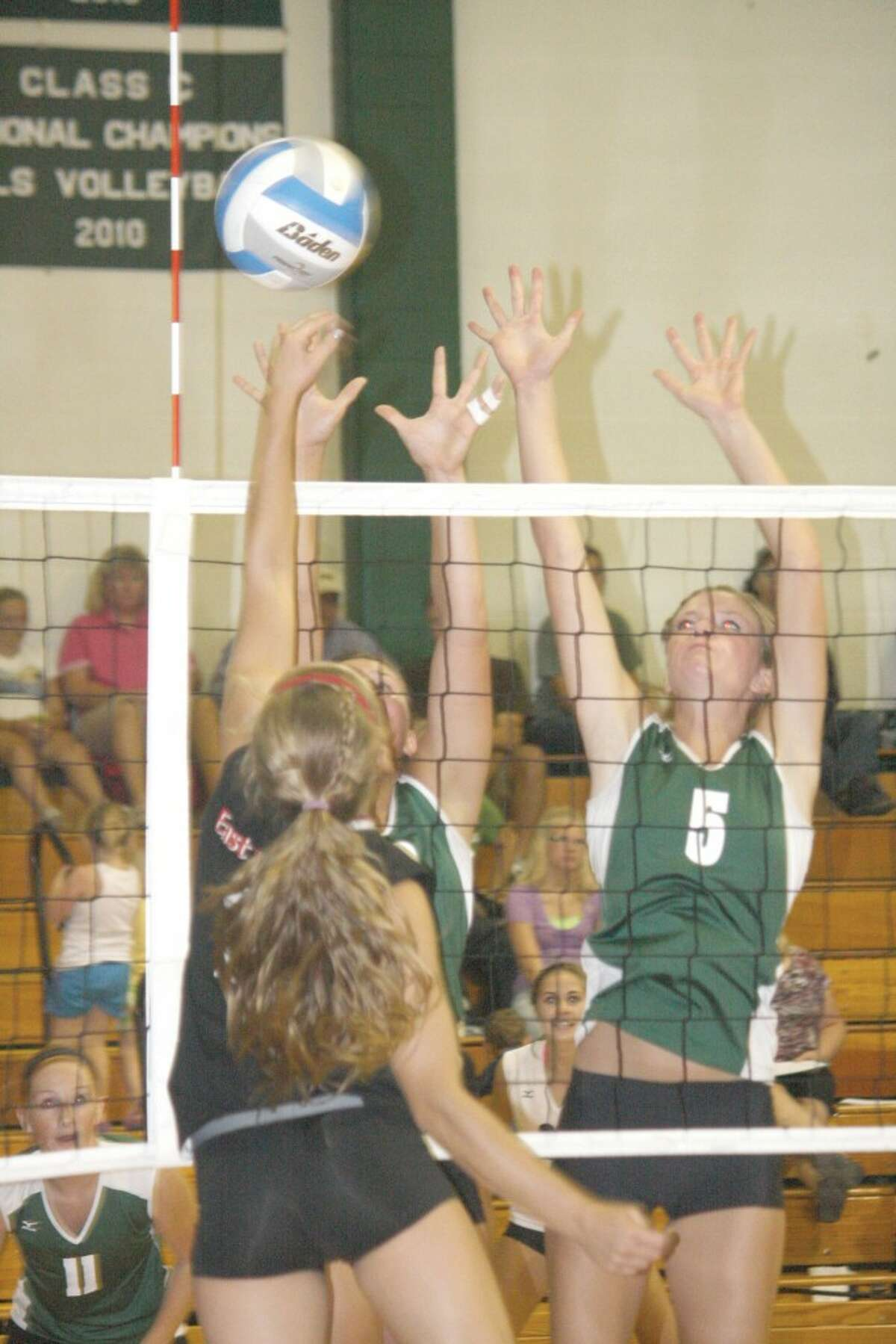 GUARDING THE NET: Jamie Justin (5) goes up for a block for Pine River.