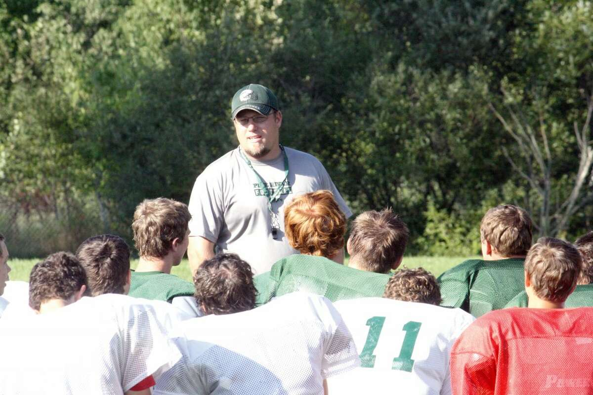 regroup: Pine River football coach Chad Phillips talks with his players at a recent practice. (Herald Review photo/John Raffel)