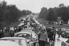 A crowd estimated to be around 300,000 struggles to leave to Woodstock Music Festival, r August 16, 1969 Assciated Press Photo