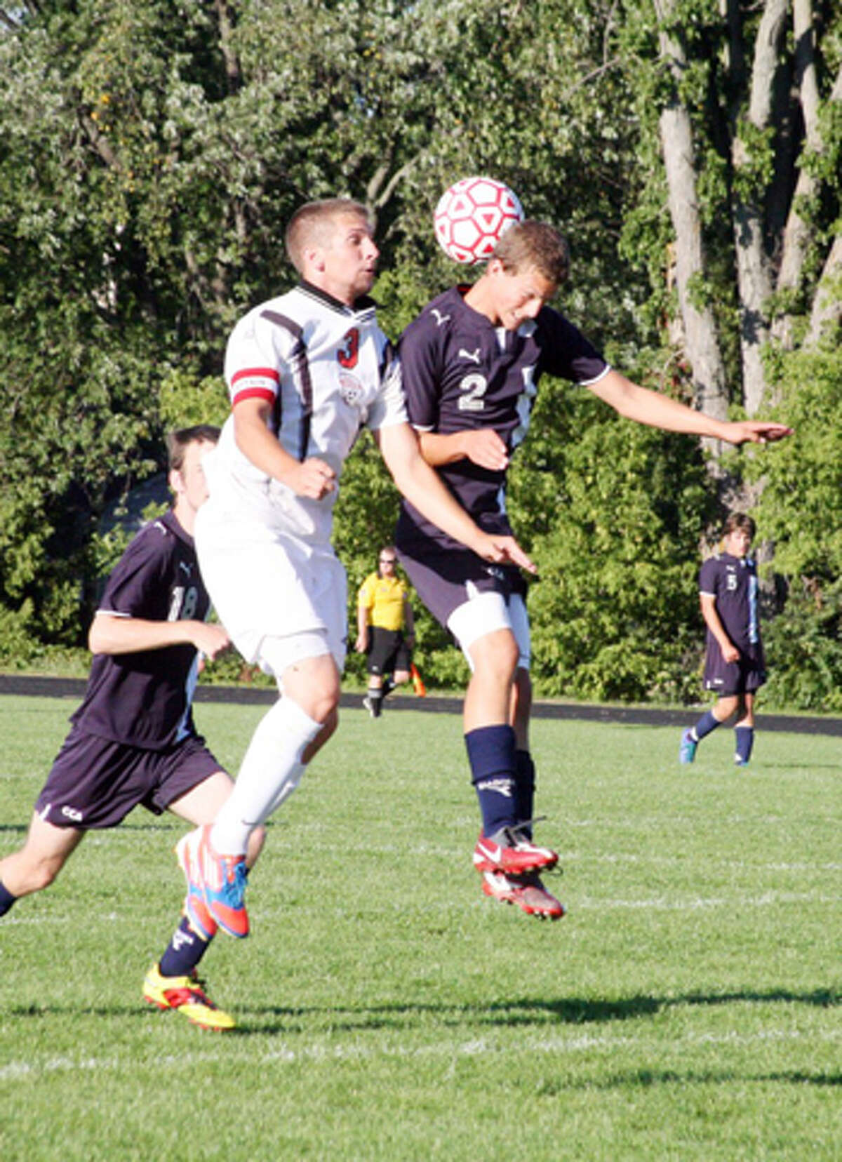 HEADS UP: Reed City's Ricky Droke goes up for a header against CCA's Justin Thorne. (Herald Review photo/John Raffel)