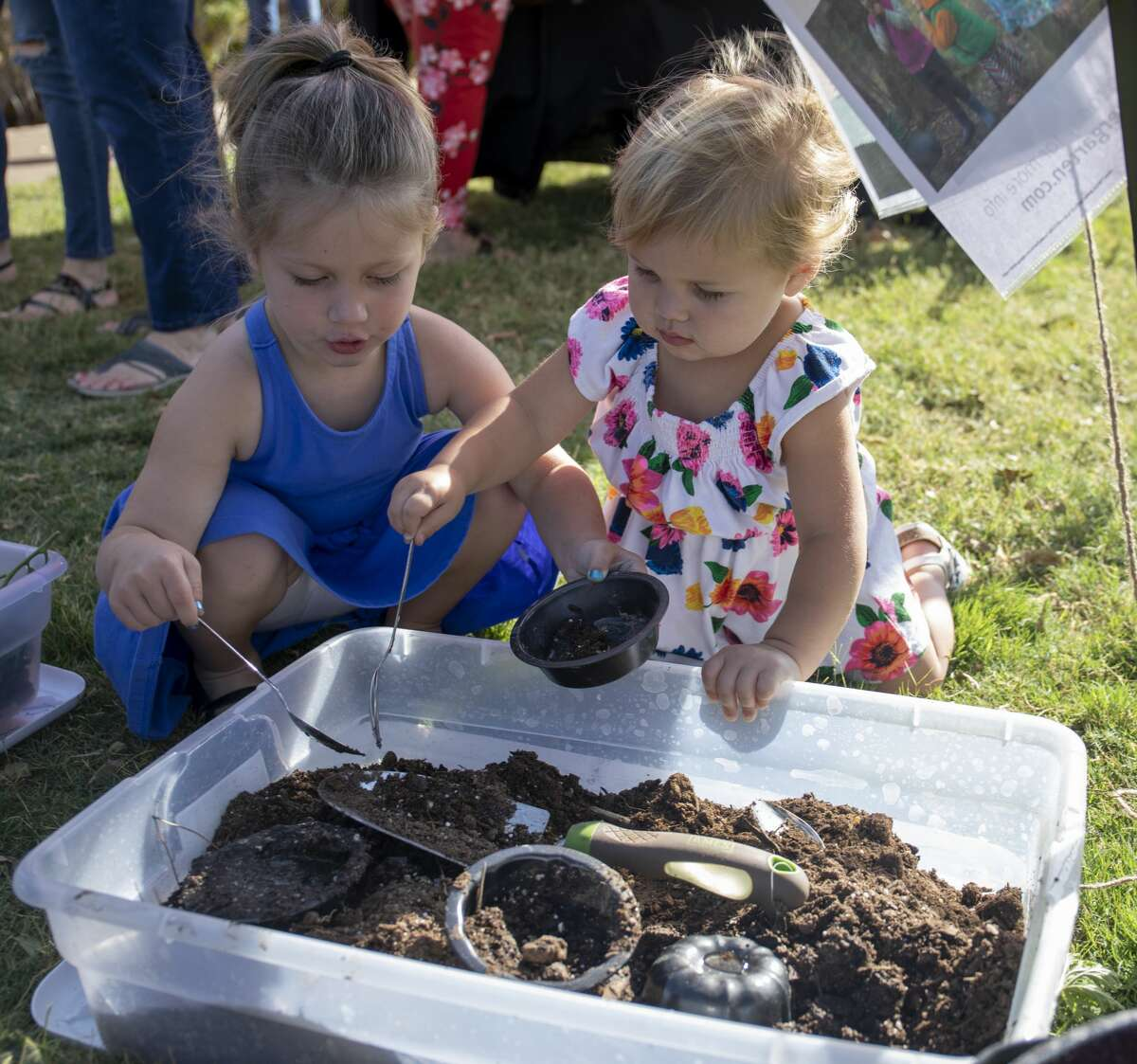 Jacqueline and Lanie Culver play with dirt at the Tinkergarten booth at the Midland Farmer's Market on Saturday, Aug. 17, 2019 at the Museum of the Southwest.