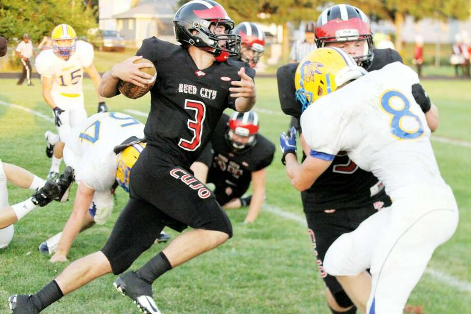 LOOKING AHEAD: Reed City's Chad Samuels looks to get some yardage during Thursday's game against Morley Stanwood. (Pioneer photo/Bob Allan)