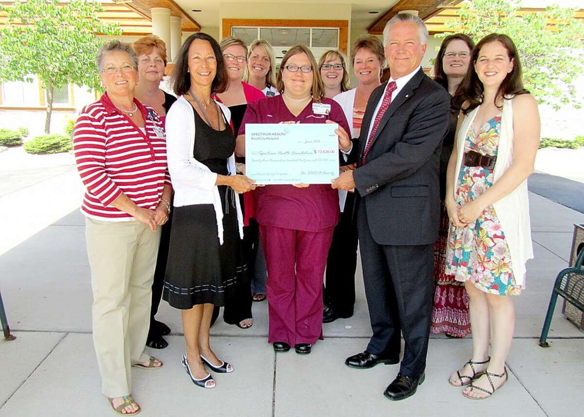 """GENEROUS GIFT: A generous donation from Spectrum Health Reed City Hospital employees aides the """"Bringing Hope Closer to Home"""" capital campaign for the Susan P. Wheatlake Regional Cancer Center. Pictured (from left to right) are Irene Balowski, Lori Jeffrey, Sheri Thompson, Mindy Fewless, Jenna Johnson, Angel Redinger, Brenda Lambrix, Kim Nix, Carl Linebaugh, Christie Carlson and Char Keysor. (Courtesy photo)"""