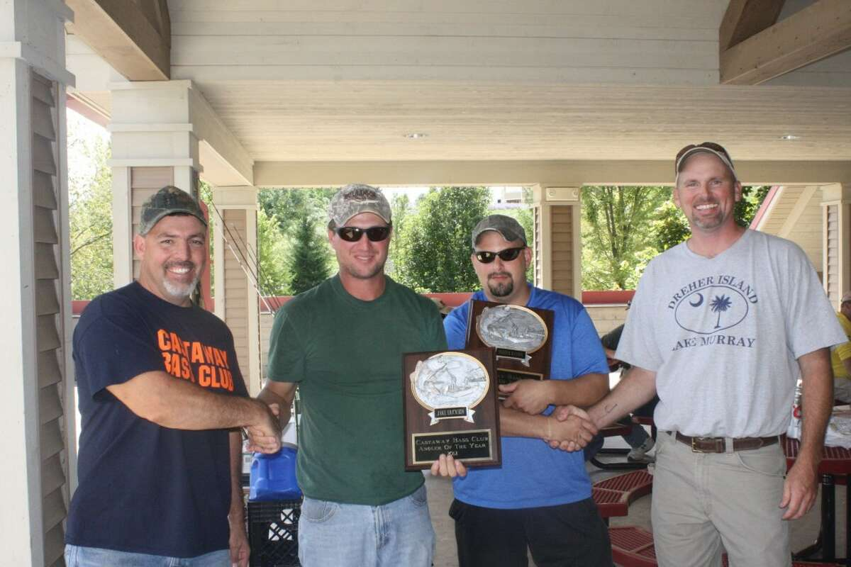 MASTER ANGLERS: Mitch Harrell, far left, and Tim Johns, far right, of the Castaways Bass Fishing Club in Mecosta County, award Jake Erickson (second from left) and Derrick Ransom as Anglers of the Year. (Herald Review photo/John Raffel)
