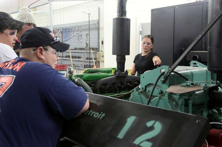 DIESEL TECHNOLOGY: Instructor Toni Valley (right) asks her students at the Mecosta-Osceola Career Center to review the work they did last year. Valley is one of four new instructors at the MOCC this year. (Herald Review photos/Lauren Fitch)