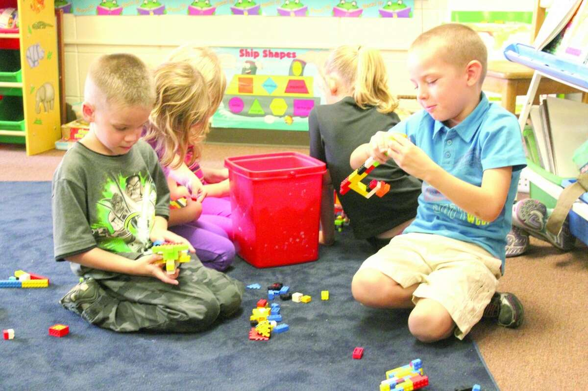 FREE TIME: Students in Sara Ladd's first grade class construct various buildings and animals with Legos during free time in their first week of class. Many students said they were looking forward to recess, math and learning. (Herald Review photo/Sarah Neubecker)