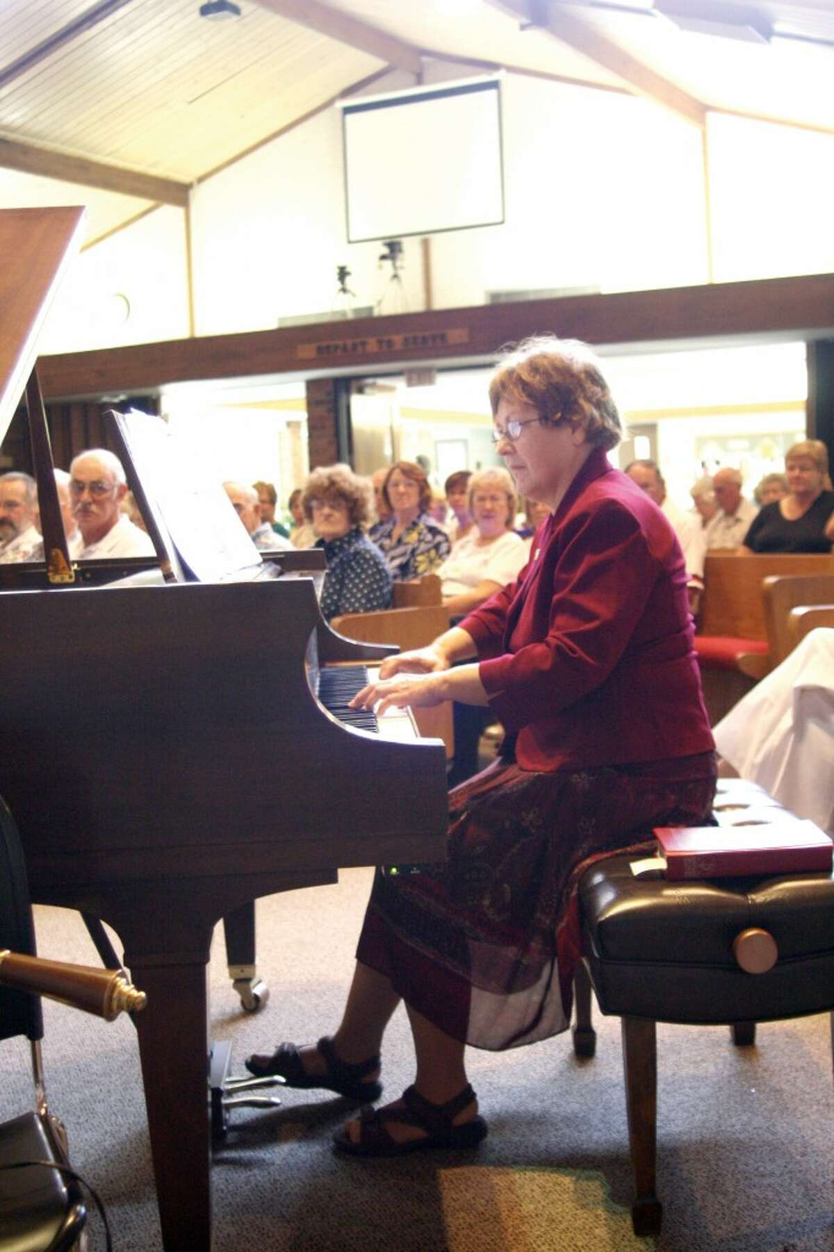 MUSICAL CELEBRATION: Lois Hinkins Stilber, a member of the Rev. George Bennard's family, plays a song for the audience at the Old Rugged Cross Centennial Celebration on Aug. 10. (Courtesy photo/Dianne Phelps)