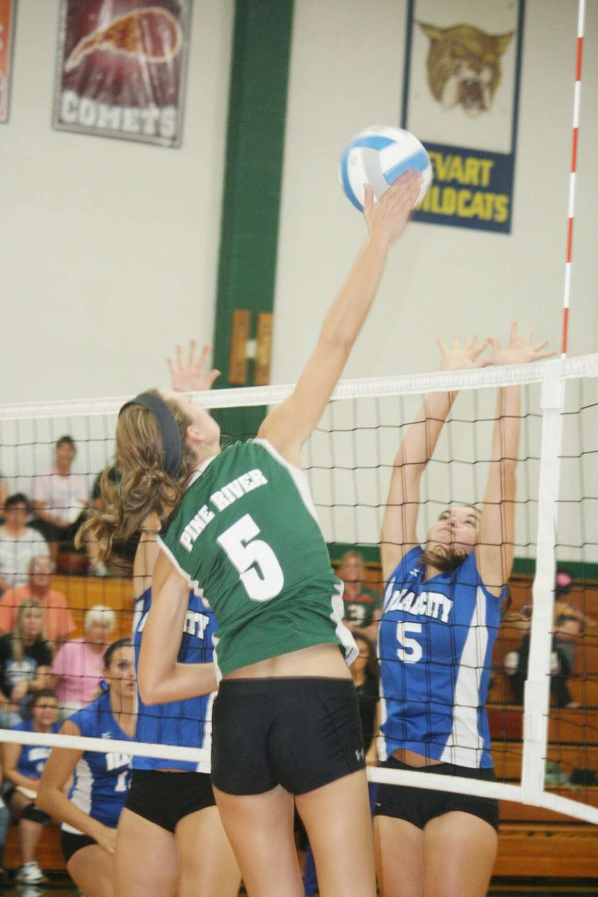 ELEVATION: Pine River's Jamie Justin (5) goes up for a kill on Tuesday against Beal City. (Herald Review photo/John Raffel)