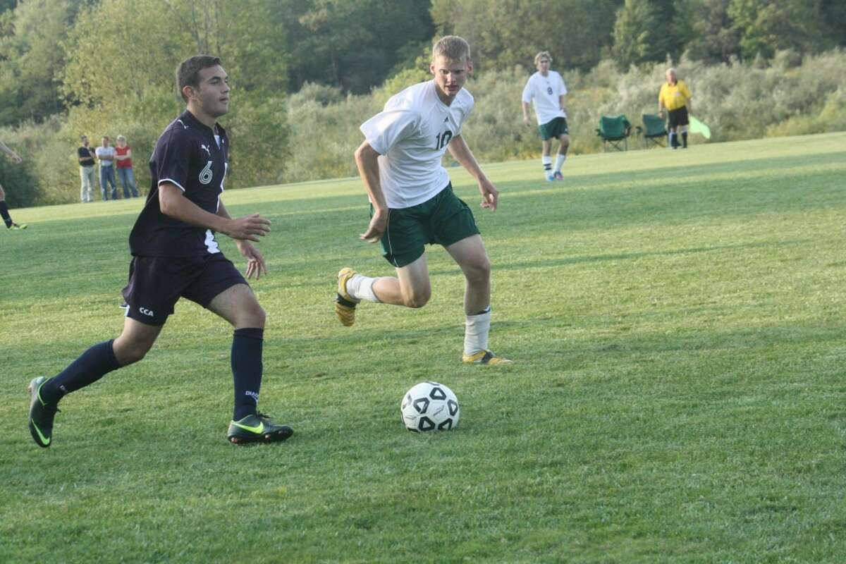 ON THE GO: Crossroads Rene Pivanti (left) looks to advance the ball up the field against Pine River. (Herald Review photo/John Raffel)