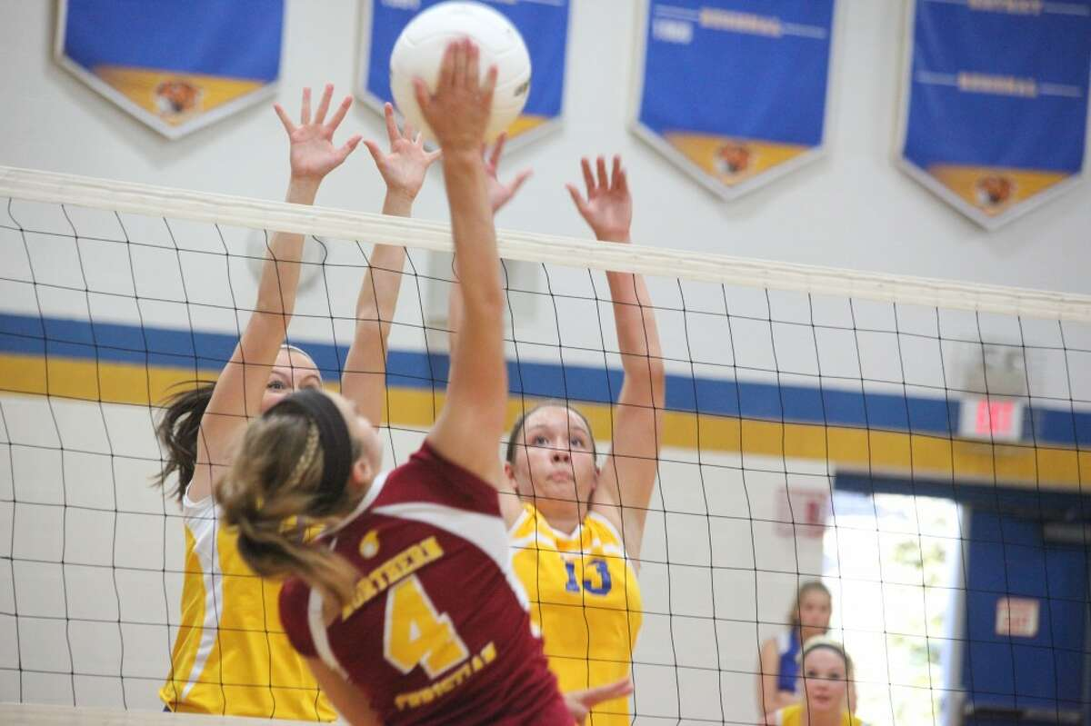 DOUBLE TEAM: Evart's Kirsten Parsons and Jessica Tea attempt to block a shot by McBain Northern Michigan Christian on Tuesday. (Herald Review photo/Martin Slagter)