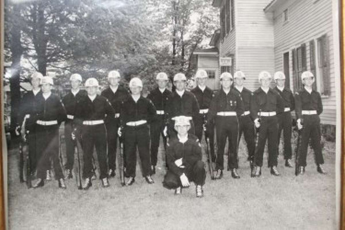 HISTORIC GROUP: Members of the VFW color guard pose in front of the VFW post in Reed City in 1954. (Courtesy photo)