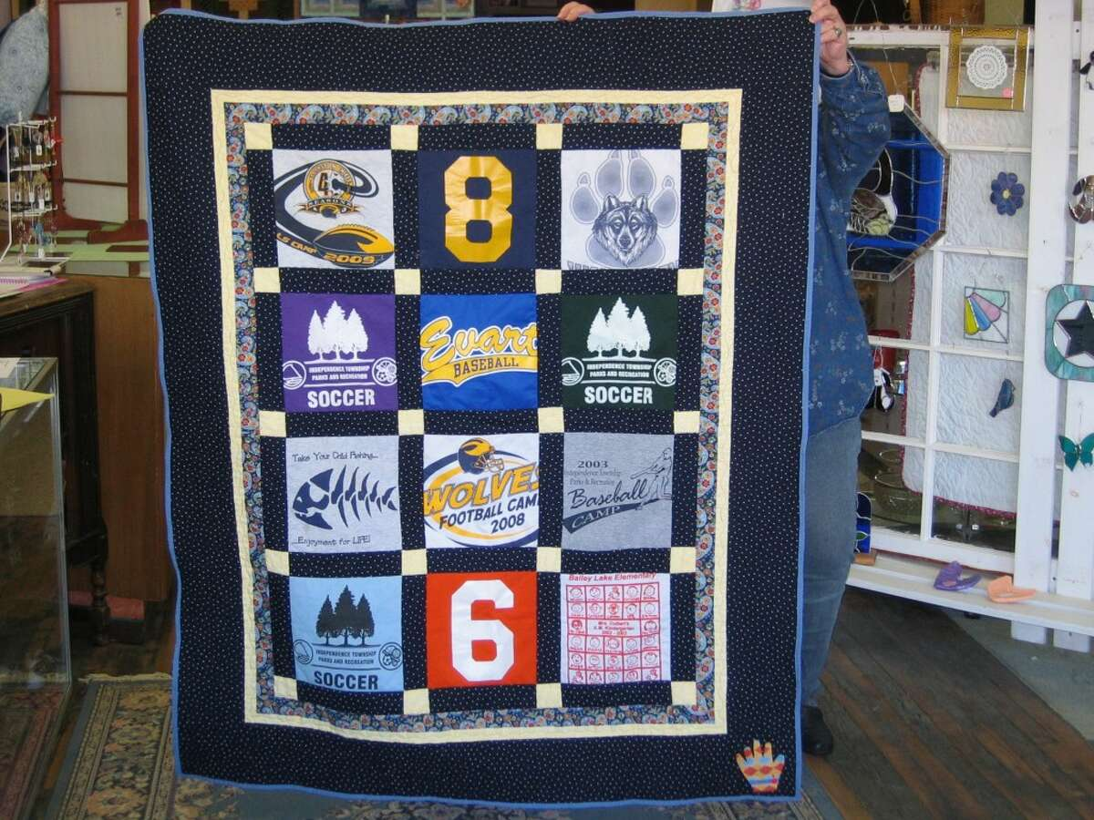 QUILTED MEMORIES: Preserving cherished memories--created by Shelley Muczynski. (Herald Review photos/Randy Johnston)