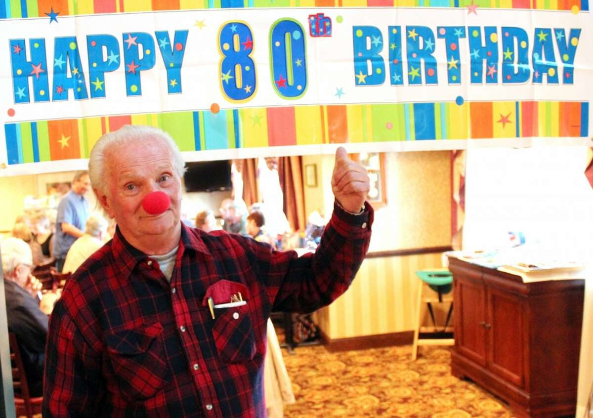 OCTOGENARIAN: Rudy Grahek, who plays Dynamite the Clown, celebrated his 80th birthday on Saturday. Family and friends organized a surprise party for the performer at the Comfort Inn and Suites in Big Rapids. (Herald Review photo/Sarah Neubecker)