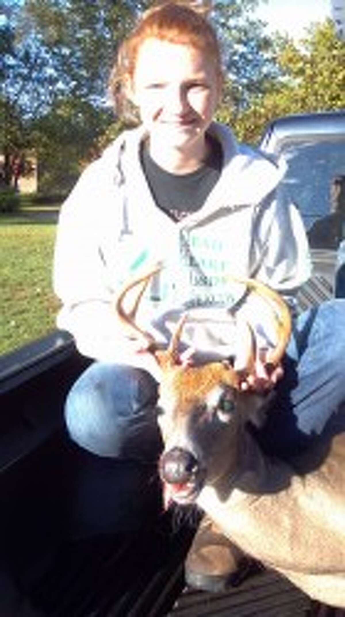 TROPHY BUCK: Meghan Borst of Reed City was a successful youth hunter over the weekend with an 8-point buck.