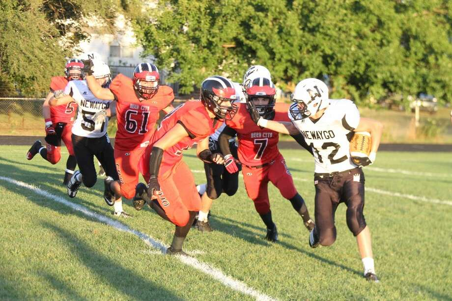 TACKLE FOR LOSS: Reed City's Eric Bradford (7) and a teammate chases a Newaygo football player in recent action. (File photo)