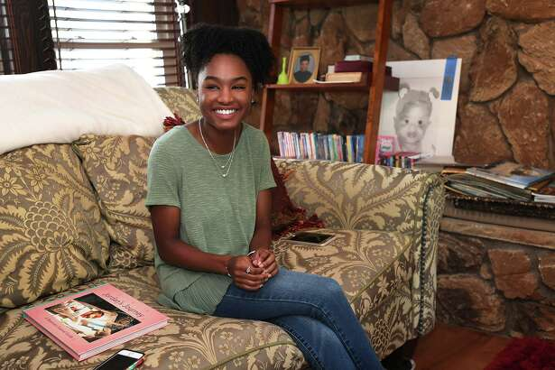 Jordan Scott talks Wednesday about the book she made to help families cope with premature births. Jordan, who was born three months premature, also submitted the book as part of her project to receive the Girl Scout's prestigious Gold Award. Photo taken Wednesday, 8/14/19