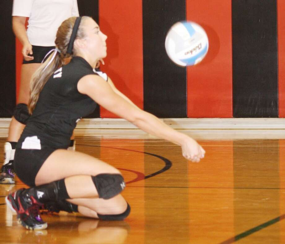 DIGGING IT: Reed City's Jacolyn Mullins digs a ball during Wednesday's high school volleyball action at Reed City High School. The Coyotes defeated Lakeview, 3-1. (Herald Review photo/John Raffel)