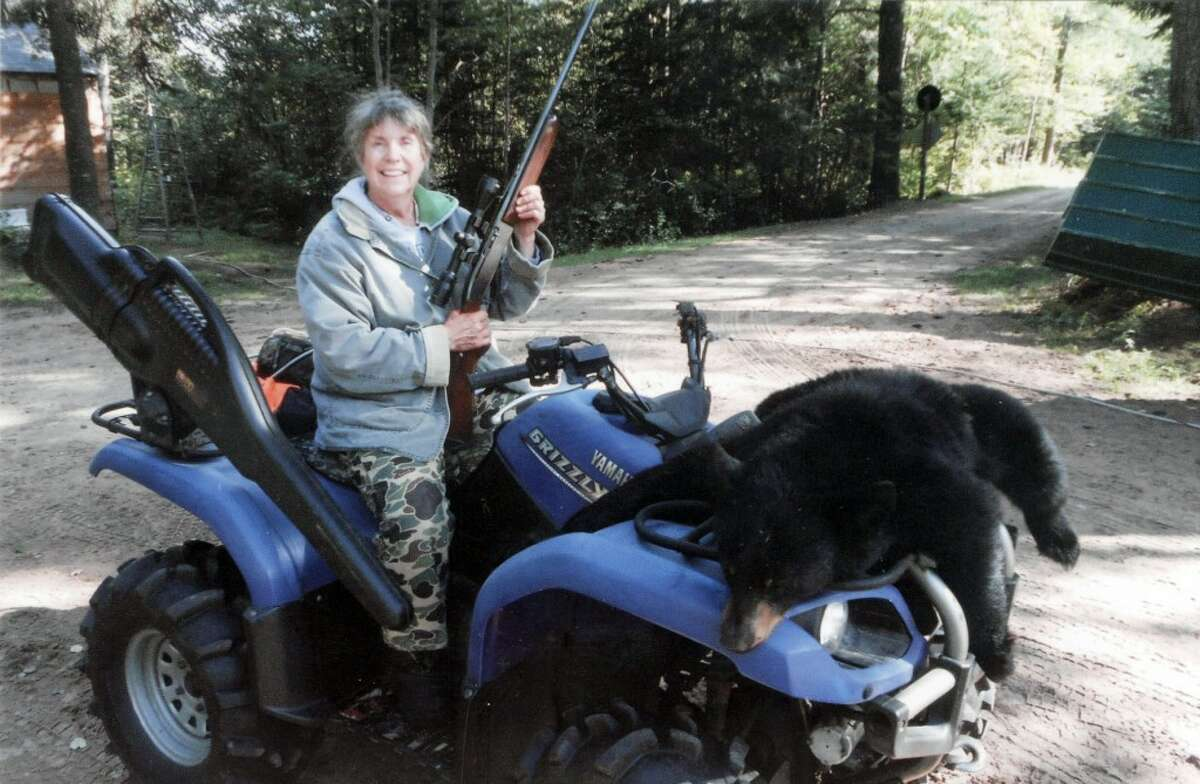 GRANNY'S GAME: Janet Hepinstall of Hersey shows the bear she bagged recently in the Upper Peninsula. (Courtesy photo)