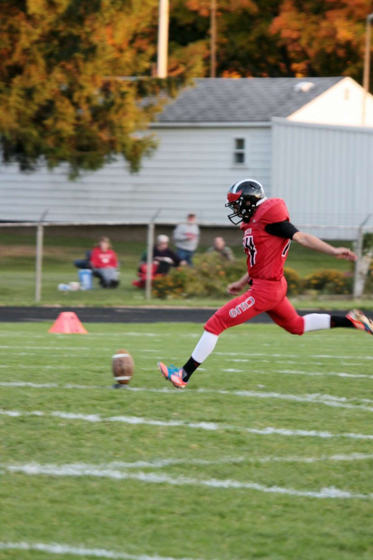 KICKING IT OLD SCHOOL: Ricky Droke does his kicking duties against Chippewa Hills. (Herald Review photo/Justin McKee)