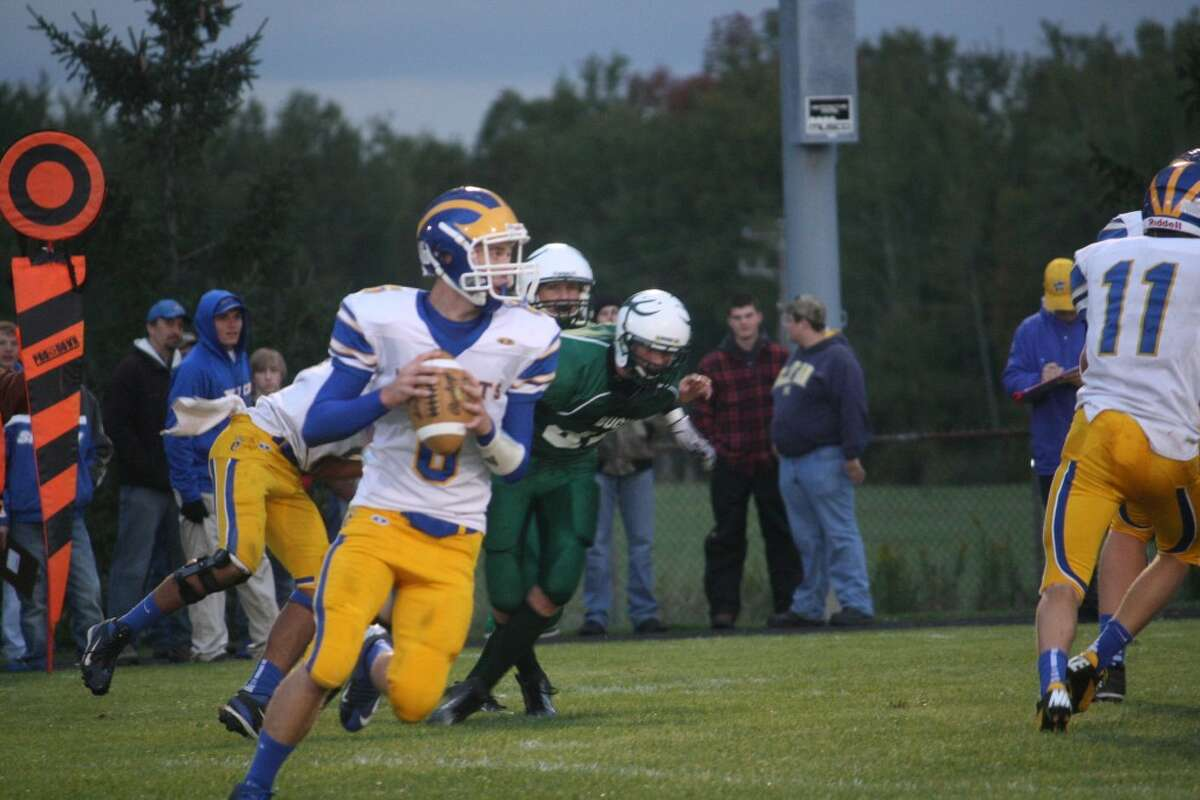 WORKING OUT OF THE POCKET: Quarterback Jacob Fortune looks downfield for an open receiver. (File photo)