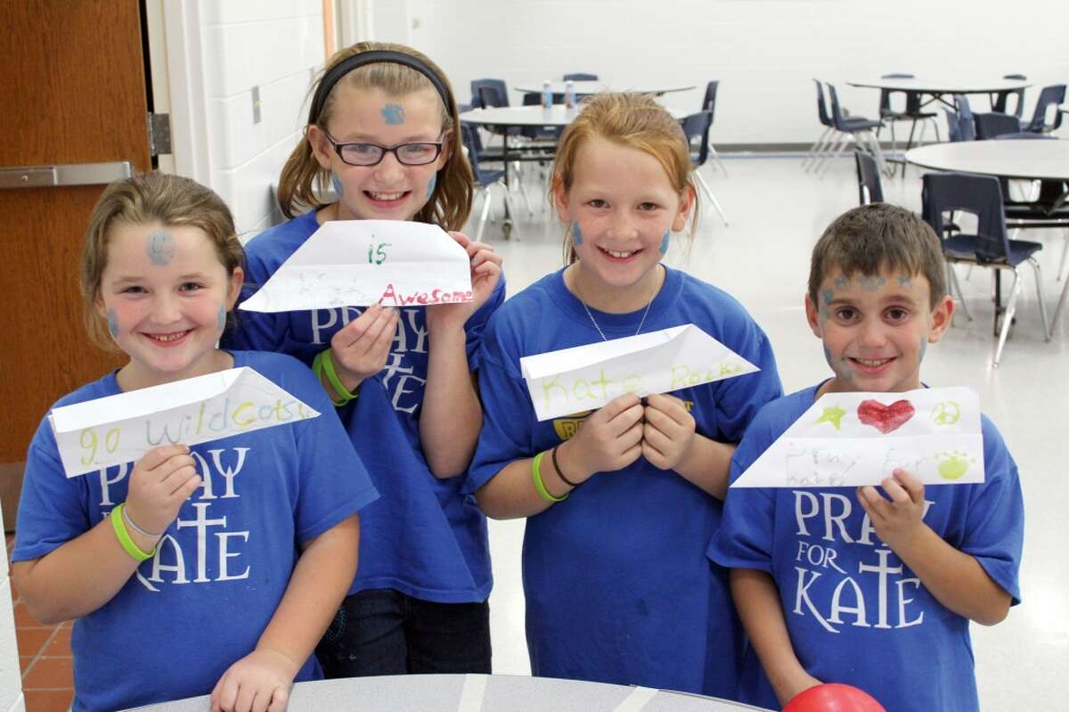 PLANES FOR KATE: Students sell paper airplanes for 25 cents each to raise money for Evart accident victim Katelyn VanMourik. Pictured from left, is Raigyn Parish, second grade; Kalin Parish, fifth grade; Keagan Parish, fourth grade and Braden Martin, third grade. (Herald Review photos/Sarah Neubecker)