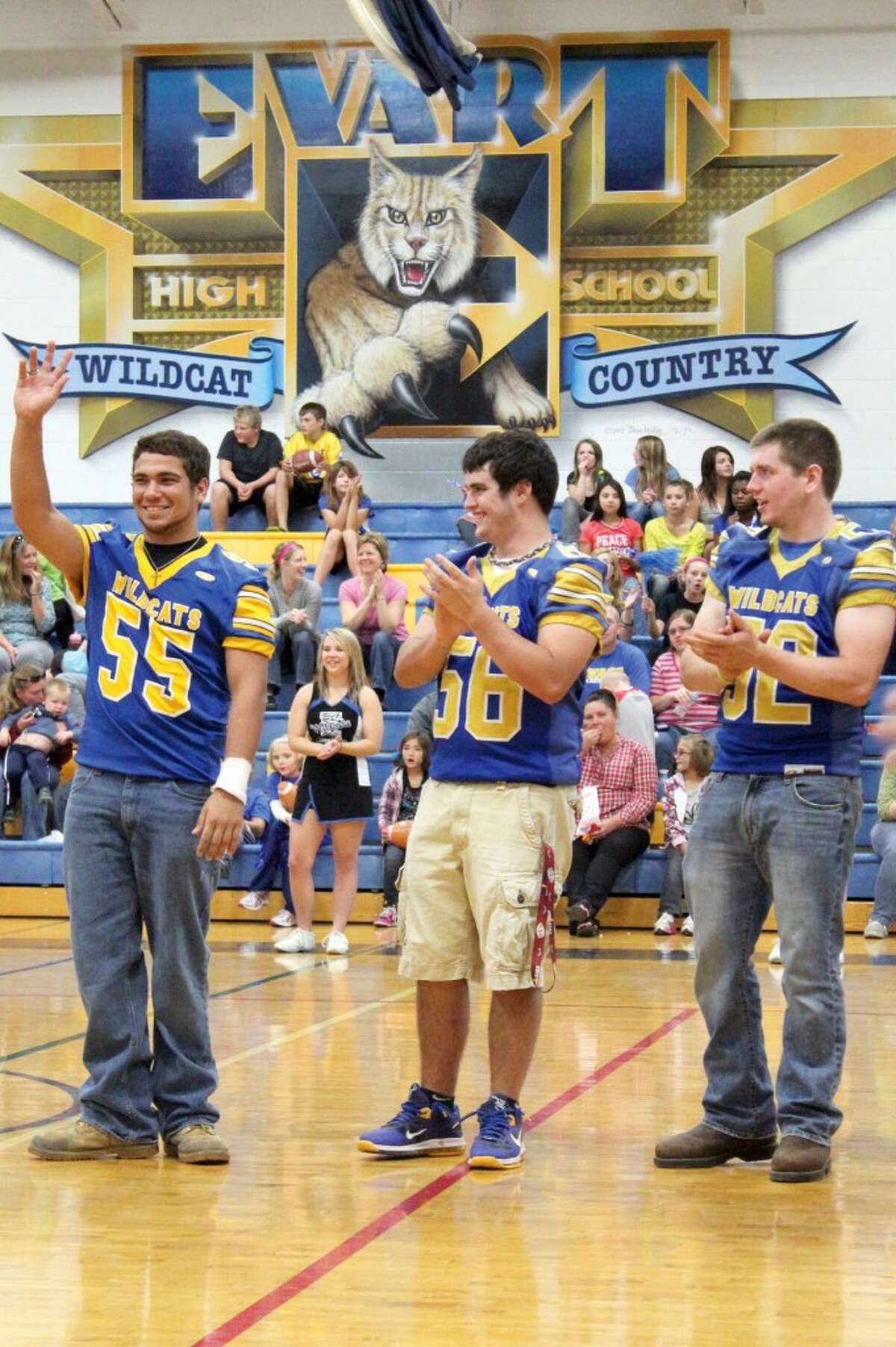 SCHOOL PRIDE: Evart High School football players are announced to district students and staff at the school's Wildcat Pride Night Sept. 26.