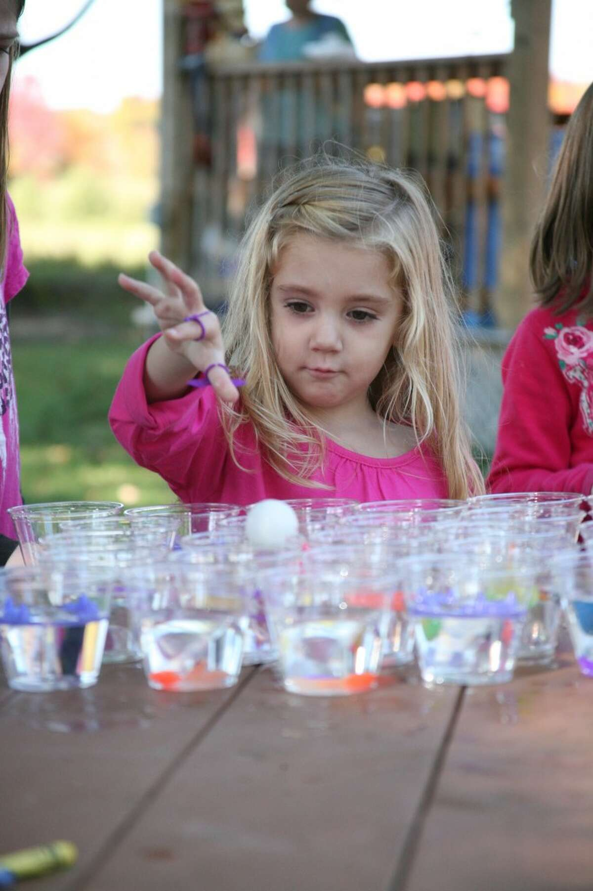 KID'S GAMES: Chloe Tyler, 3, plays a game during the third annual Hersey Harvest Food Drive Festival on Saturday at Mosaic Park.