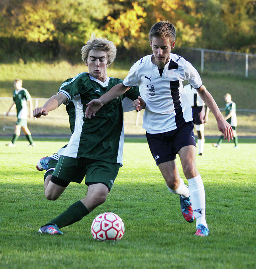 CONTROL: Crossroads' Blake McKenzie looks to advance the ball up the field against Pine River on Tuesday. (Herald Review photo/Bob Allan)