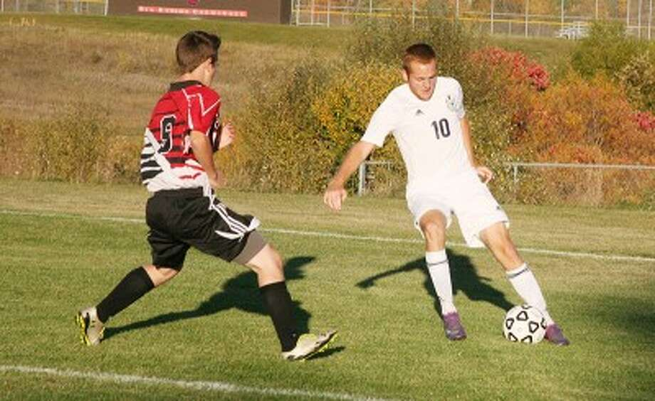 FOCUS: Big Rapids' Andrew Klarecki looks to make a move on a Reed City defender during the Cardinals' 6-0 win on Tuesday. (Herald Review photo/Martin Slagter)