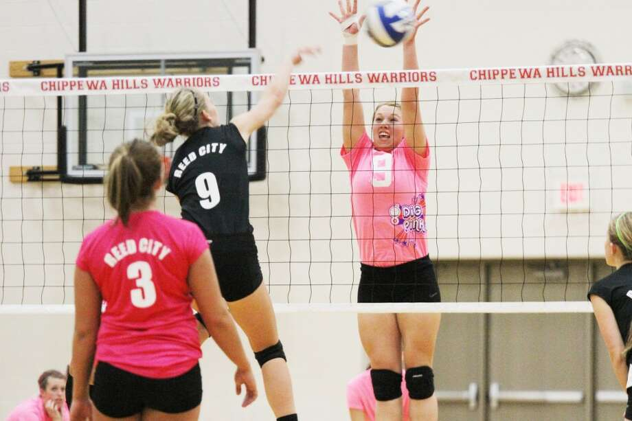 ON THE MOVE: Chippewa Hills' Olivia Wolfe (right) goes up for the block on an attack of Reed City's Natalie Westhoff during Wednesday's contest. (Herald Review photo/Bob Allan)