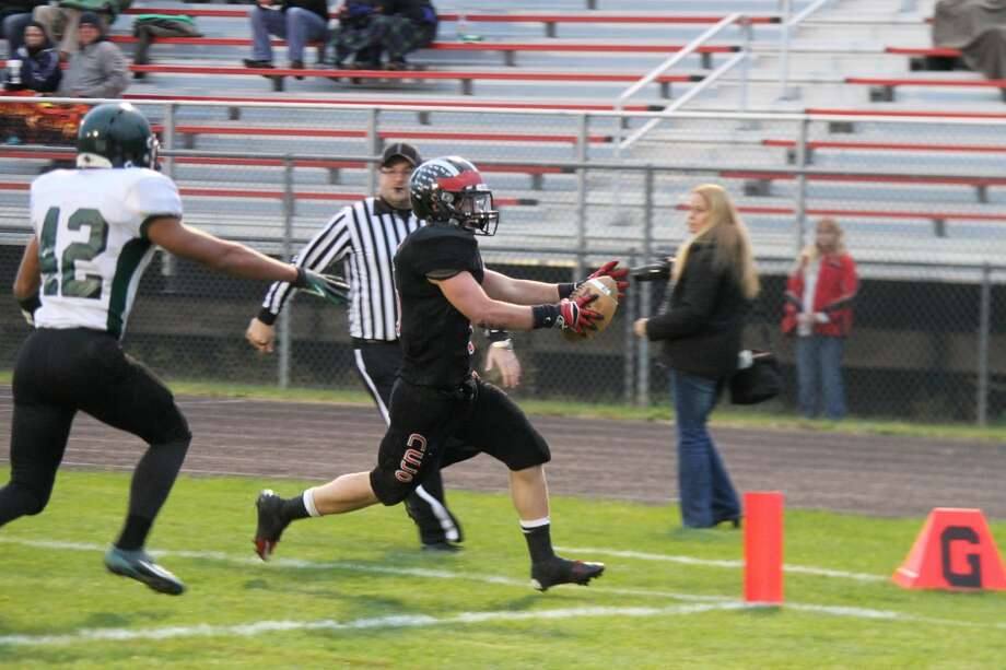 TOUCHDOWN: Reed City's Garrett Benson extends his arms for another touchdown against Hesperia on Friday. (Herald Review photo/Martin Slagter)