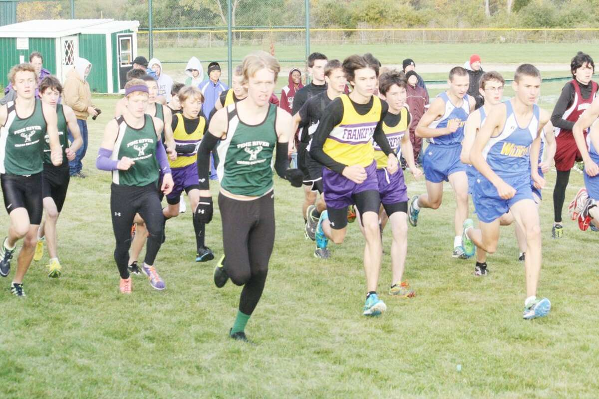 AND THEY'RE OFF: Pine River and Evart runners get off to a flying start during the Pine River Invitational. (Herald Review photo/John Raffel)