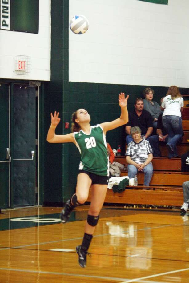 CLEAR SHOT: Kassy Nelson gets ready to serve the ball for Pine River in recent volleyball action. (Herald Review photo/John Raffel)